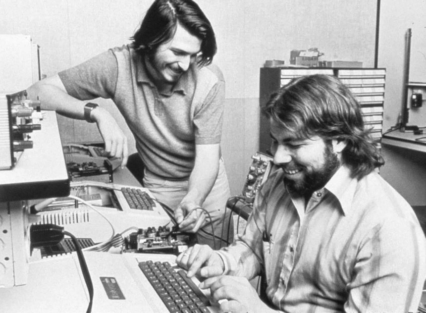 Steve Wozniak and Steve Jobs working on the Apple II